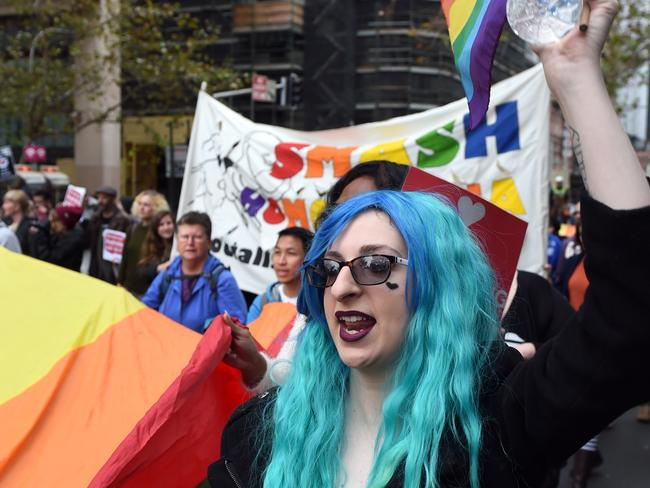 Time for change ... Demonstrators take part in a marriage equality rally in Sydney. Picture: AAP/Paul Miller