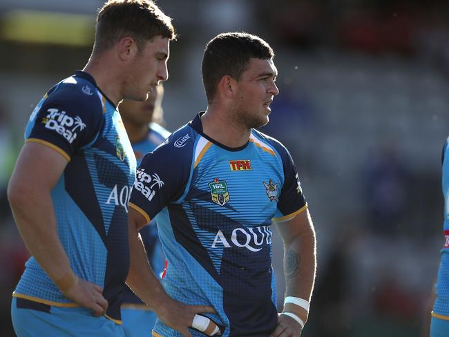 Ash Taylor of the Titans looks dejected after a Dragons try.