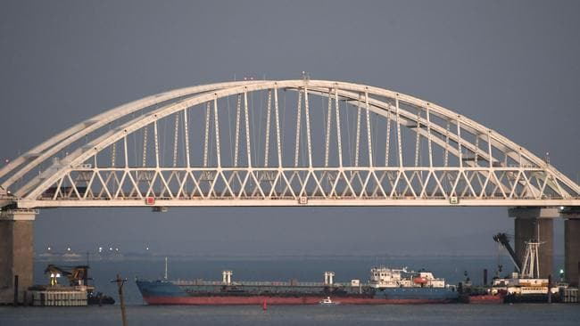 A ship under the Kerch bridge blocks the passage to the Kerch Strait near Kerch, Crimea, on Sunday, November 25. Russia and Ukraine traded accusations over an incident at sea increasing tensions between both countries. Picture: AP