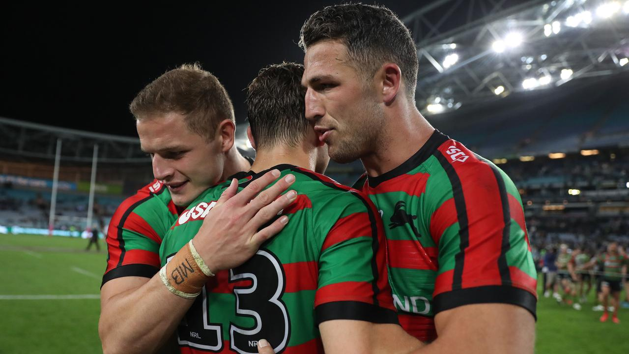 George and Sam Burgess congratulate two-try hero Cameron Murray.