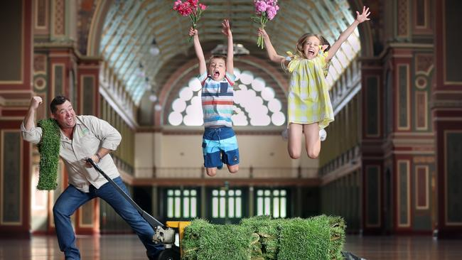 Better Homes and Gardens presenter Jason Hodges tries out the turf at the Royal Exhibition Building, with Zac, 7 and Charli, 9. Picture: Alex Coppel