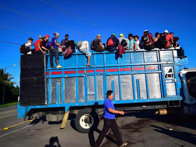 Honduran migrants board a truck in Metapa on their way to Tapachula. Picture: AFP