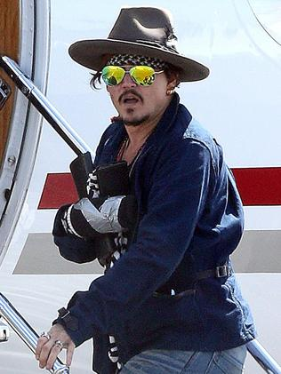 Johnny Depp leaving Brisbane airport on a private jet.