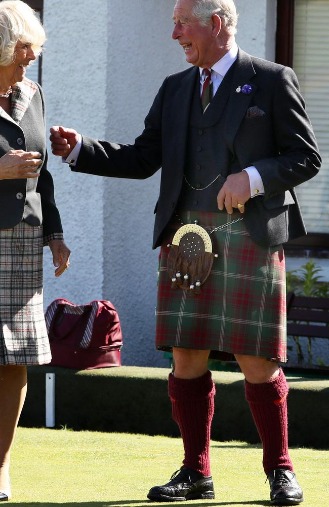 Charles and Camilla. They're laughing because he normally wears his bright blue socks with this outfit. Picture: Getty