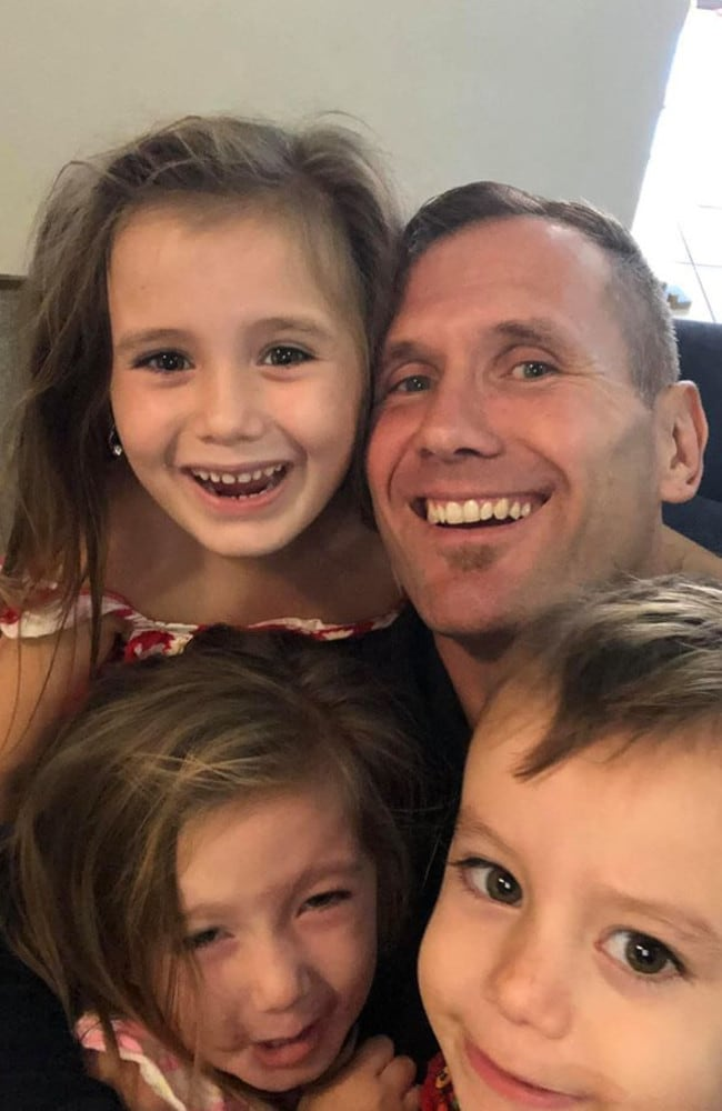 Rowan Baxter with his children. All four were killed in a car fire at Camp Hill. Photo: Facebook