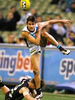 Round 19: Chat Wingard gets a kick away at the MCG. Picture: Wayne Ludbey