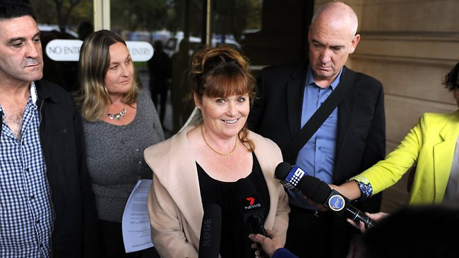 Anne Redman's daughter Suzanne Redman speaks to the media after her mother's killers lost their appeal. She's standing with husband Chris Miller, right, and sister Karen with husband Terry Batsiokis. Picture: Greg Higgs