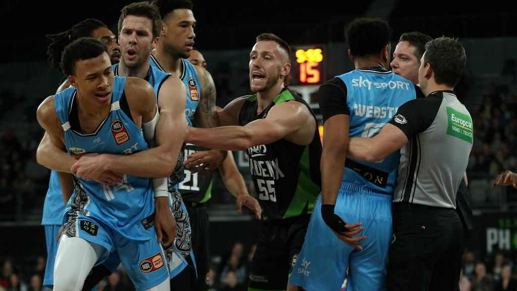 R.J. Hampton had knocked screener Ben Madgen down to the ground, and Roberson and Hampton got into it, which resulted in Hampton's ejection.  (Photo: AAP, via Herald Sun)