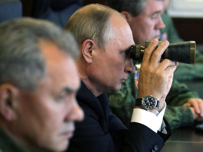 Russian President Vladimir Putin, accompanied by Defence Minister Sergei Shoigu, nspects the joint Zapad-2017 (West-2017) Russian military exercises with Belarus. Picture: AFP