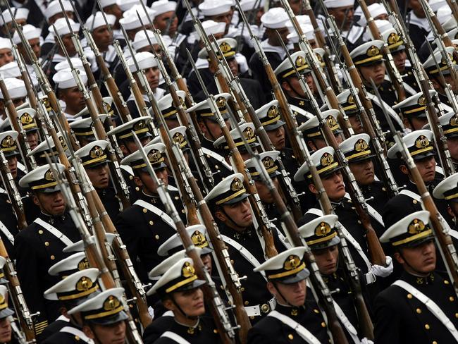 Bolivian navy soldiers take part in a parade during celebrations for the anniversary of the War of the Pacific. Picture: Dado Galdieri/AP