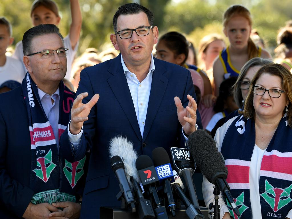 Victorian Premier Daniel Andrews (centre) announcing the investment in footy venues. (AAP Image/Joe Castro)