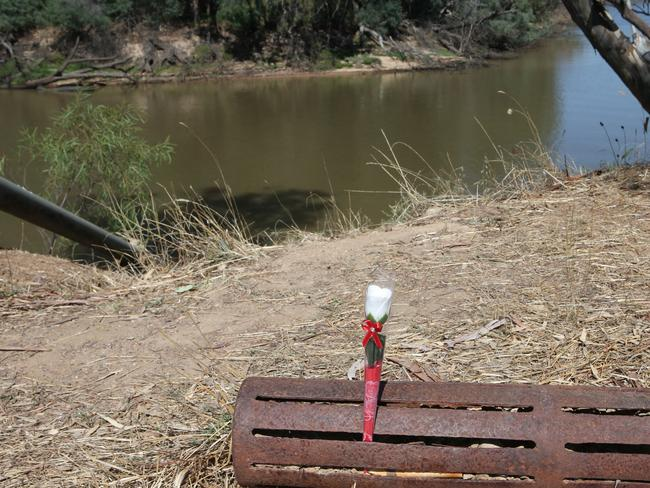 Flowers were placed on the banks of the Murray River in Moama after the boy's body was found. Picture: David Crosling