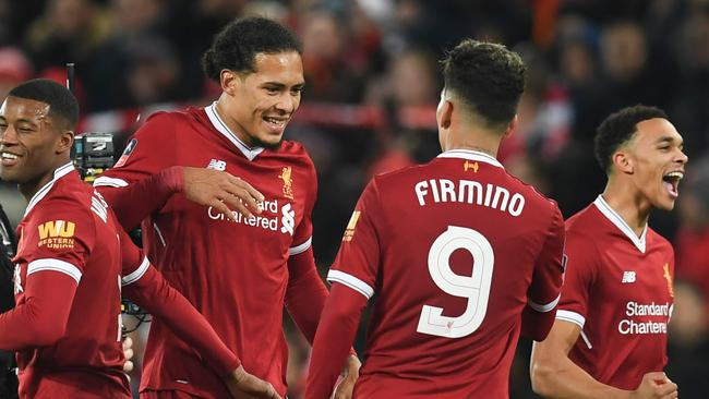 Liverpool's Dutch defender Virgil van Dijk (C) celebrates with Liverpool's Brazilian midfielder Roberto Firmino