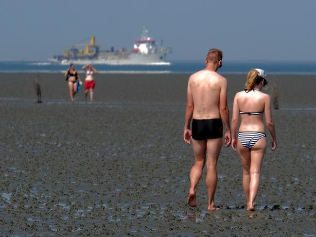 People hit the beach in Cuxhaven, northern Germany, on June 25, 2019 as temperatures topped 33 degrees Celsius. Picture: Patrik Stollarz/AFP