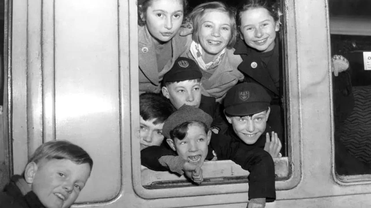 Children board a train at St Pancras Station, London, at the start of their journey to Australia.