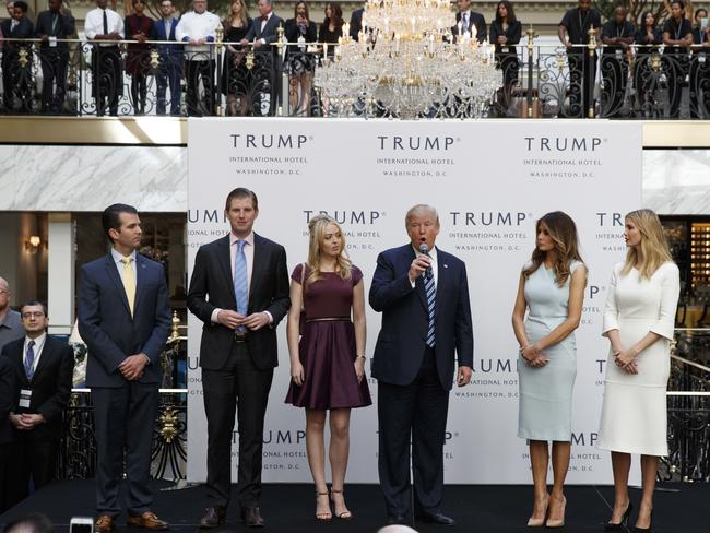 Donald Trump, accompanied by, from left, Donald Trump Jr., Eric Trump, Trump, Melania Trump, Tiffany Trump and Ivanka Trump, speaks during the grand opening of the Trump International Hotel- Old Post Office, in Washington in October. Picture: AP