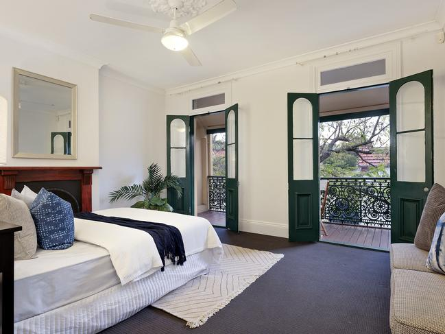 The main bedroom has double doors that lead to a balcony.