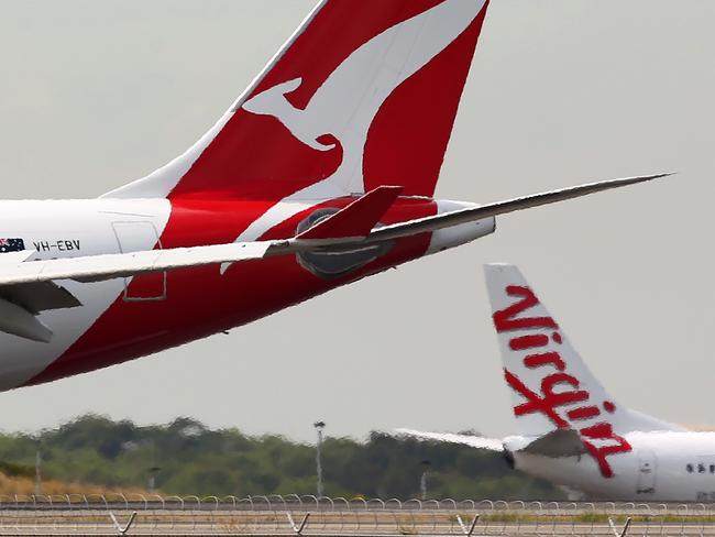 Qantas, Virgin Australia and Woolworths refuse to reduce