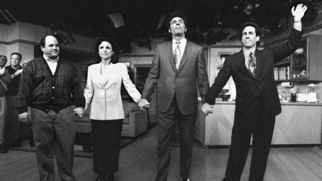Jason Alexander with Julia Louis-Dreyfus, Michael Richards and Jerry Seinfeld waving goodbye after filming the final episode of Seinfeld.