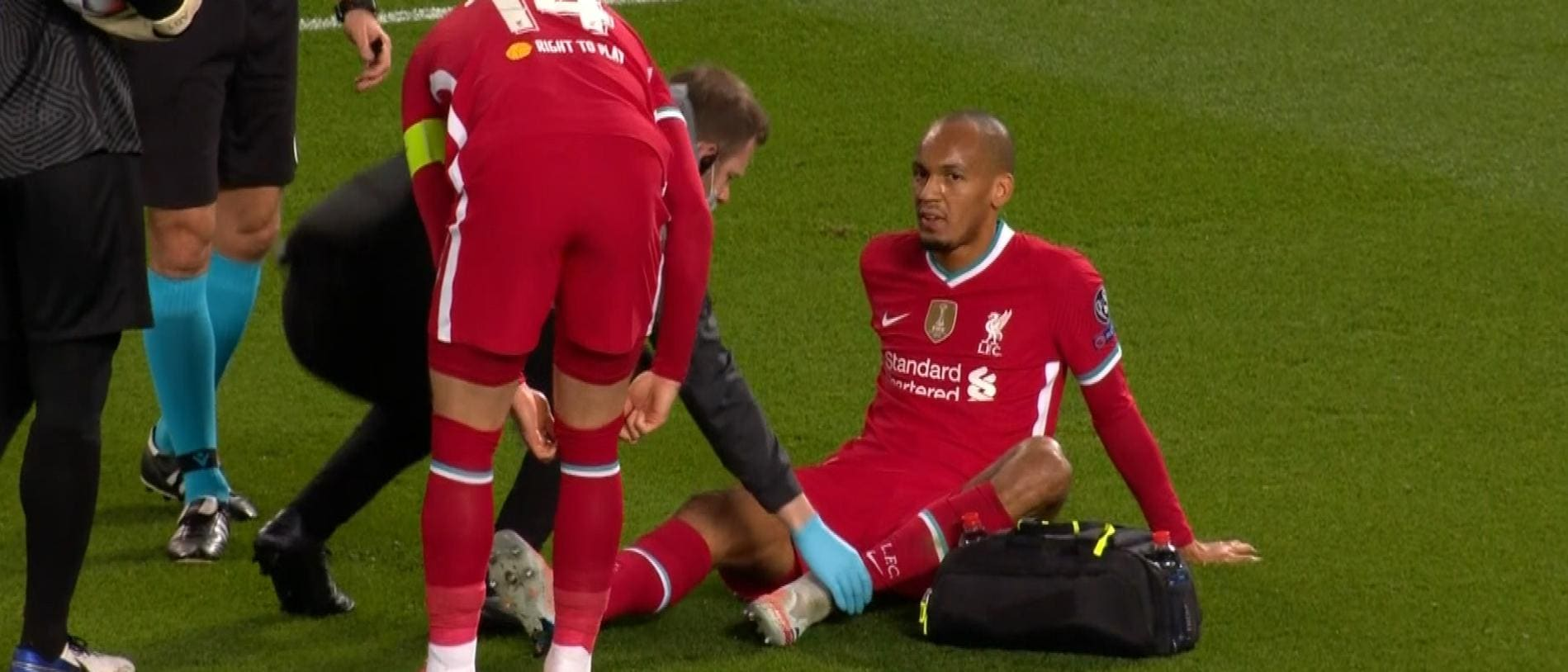 Fabinho went off injured in the first half.