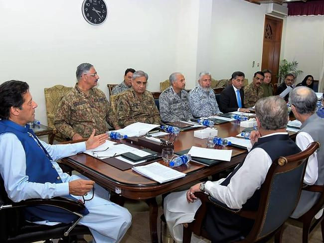 Pakistan's Prime Minister Imran Khan (L) chairs a National Security Committee meeting along with armed forces chiefs and other government officials in Islamabad. Picture: AFP