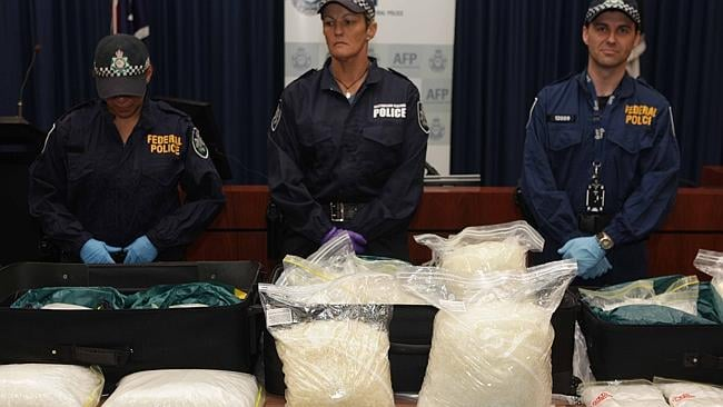 Australian Federal Police Officers in Sydney display some of the $14.4 million worth of methamphetamine and $300,000 cash seized in December, 2010. Picture: AAP.