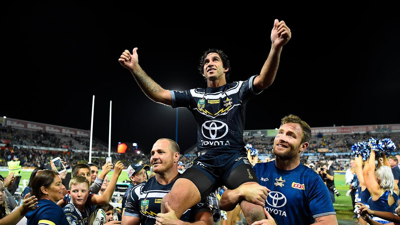 Johnathan Thurston of the Cowboys is chaired from the ground after playing his last home.