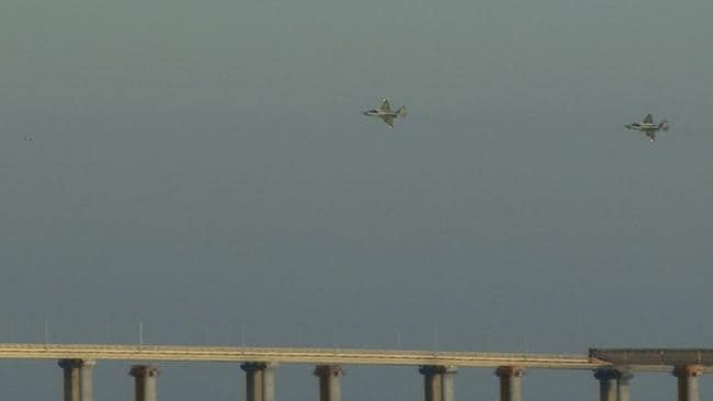 s Russian aircraft flying over the Crimean Bridge that spans the Kerch Strait. Picture: Kerch Info/AFP