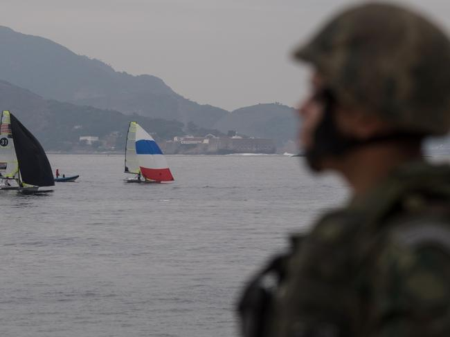Brazilian marines patrol Flamengo Beach, near the site that will host the sailing competitions of the Rio 2016 Olympic Games. Picture: Christophe Simon
