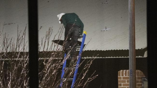 Police are working to bring inmates down from the facility's roof. Picture: Dean Asher
