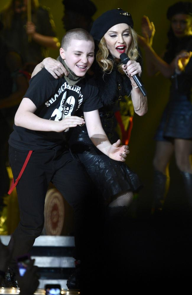 In happier times ... Rocco Ritchie and his mother Madonna perform on stage during her MDNA tour. Picture: Kevin Mazur/WireImage