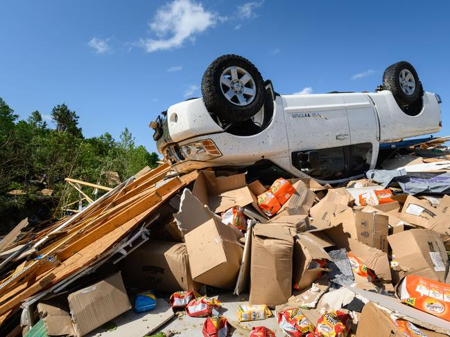 A truck is seen overturned near the remains of the Donnie Braun and Sons Auto Repair on May 23, 2019 in Jefferson City, Missouri. Picture: Getty