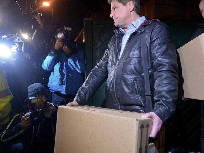 Discovery ... Investigators carry boxes from the apartment of Andreas Lubitz. Picture: Sascha Steinbach/Getty Images