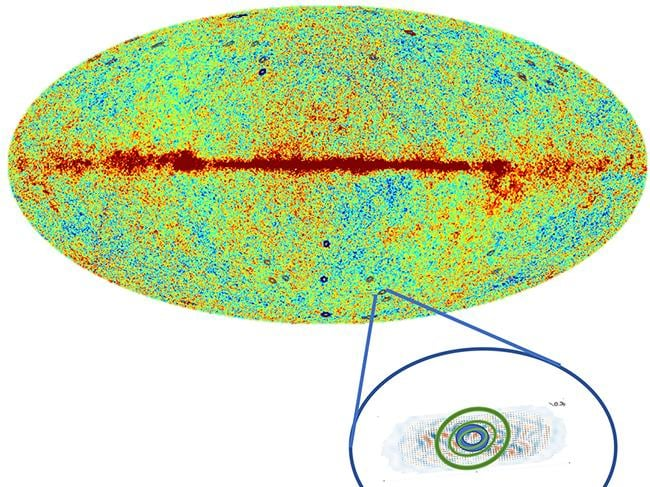 Researchers propose that the black circled patches, above, represent Hawking Points — the ghosts of black holes from a previous universe.