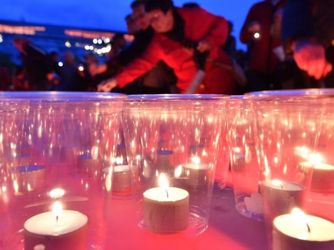 People light candles to after an anti—semitic shooting shocked Germany. Picture: AFP
