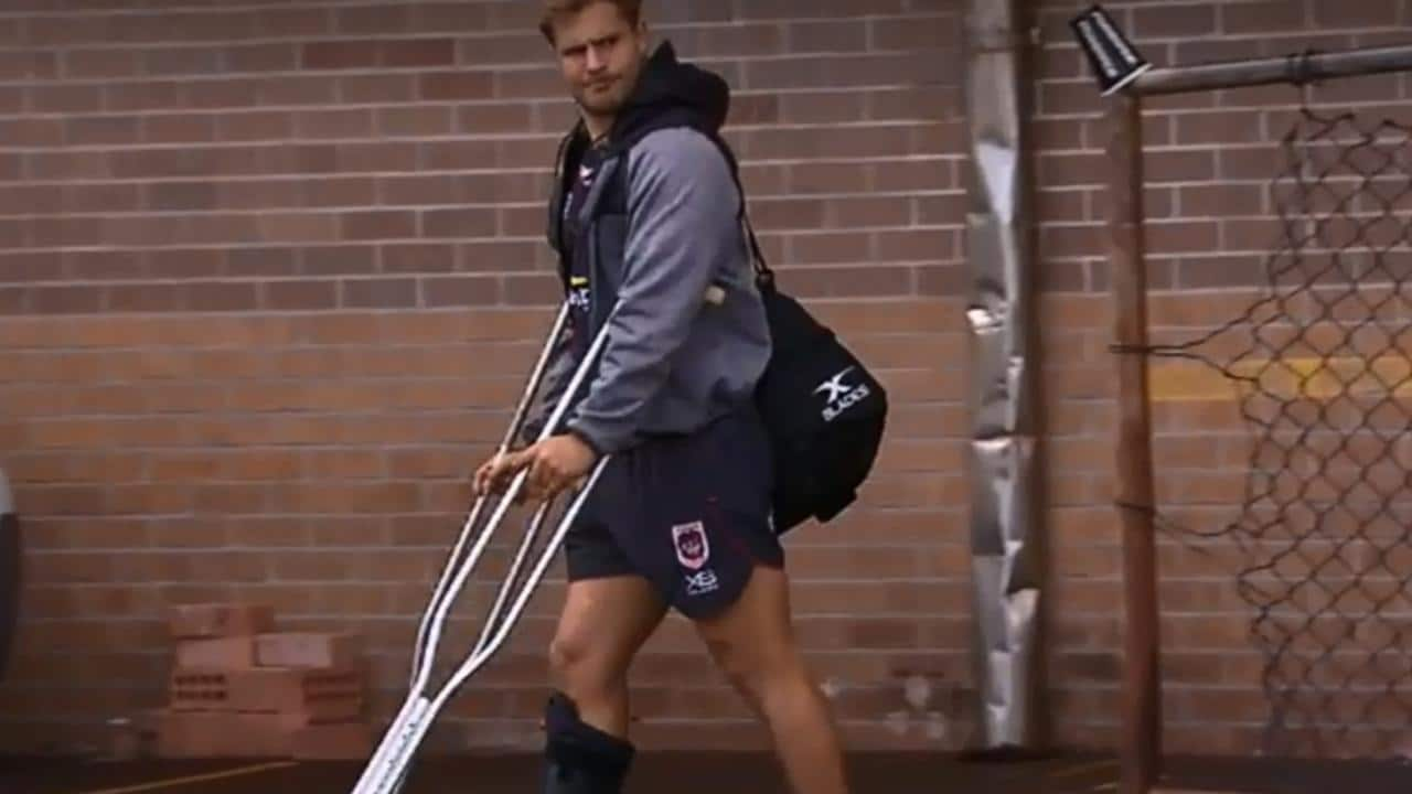 Jack De Belin leaves the Dragons team facility on crutches and wearing a moon boot.
