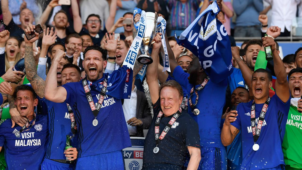 Cardiff City celebrate gaining promotion to the Premier League after winning the Sky Bet Championship playoff match against Reading.