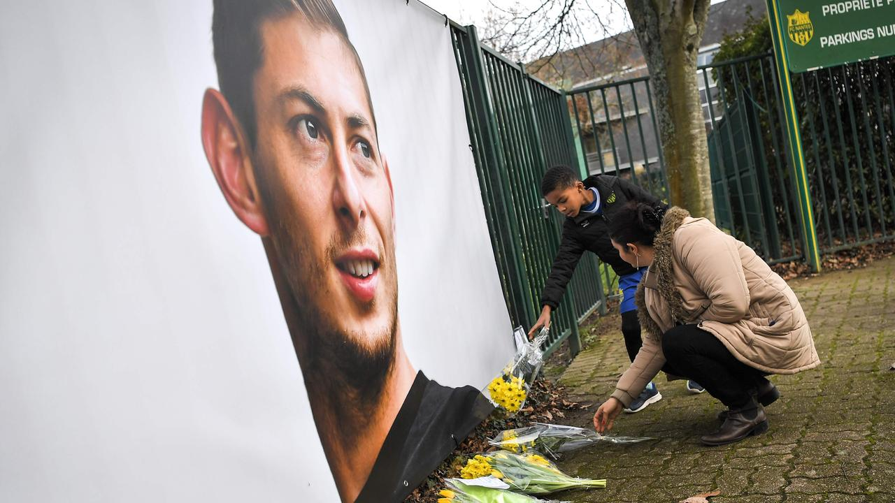 People put flowers in front of the entrance of the FC Nantes football club training center La Joneliere in La Chapelle-sur-Erdre.
