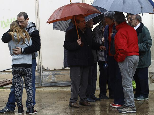Tragedy ... residents of Llinars del Valles react after observing a minute of silence to honour the victims of the crash. Picture: AFP