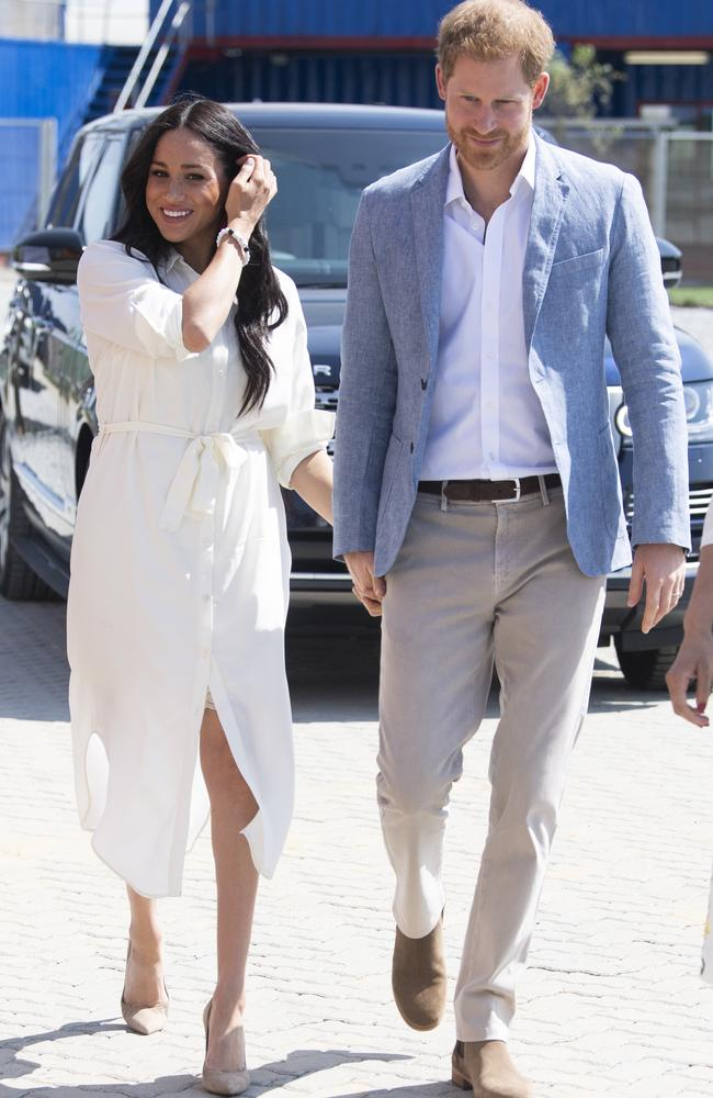 Prince Harry and Meghan Markle speak on the final day of their tour. Picture: Facundo Arrizabalaga — Pool/Getty Images