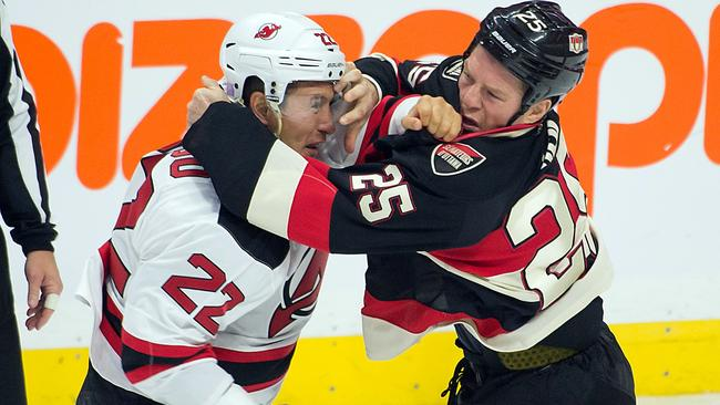 Ottawa Senators right wing Chris Neil (R) fights with New Jersey Devils right wing Jordin Tootoo.