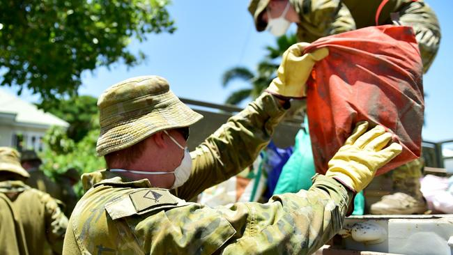 Troops from the Australian Defence Force helping clean up Townsville suburbs affected by the Townsville floods. GNR Jackson Wolfe