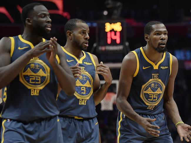 Golden State Warriors' Draymond Green, Andre Iguodala and Kevin Durant.