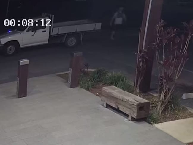 CCTV shows the man leaving his ute and walking towards the woman who is standing in front of the Park Ave Hotel just after midnight. Picture: Queensland Police Service