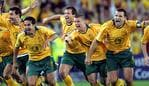 07/06/2006 LIBRARY: Socceroos players including captain Mark Viduka (7), celebrate after Australia defeated Uruguay in 2006 FIFA World Cup Qualification (2nd leg) match at Telstra Stadium, Olympic Park, Homebush in Sydney.