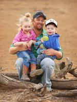 Peter Holcombe, 32, Eve Holcombe, 3, Finn Holcombe, 2 on their dry land near Walgett. Picture: Sam Ruttyn