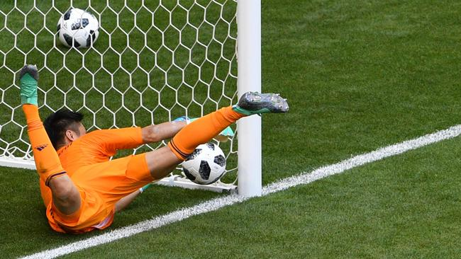 Japanese goalkeeper Eiji Kawashima fails to save Colombian midfielder Juan Quintero's free kick. Picture: AFP
