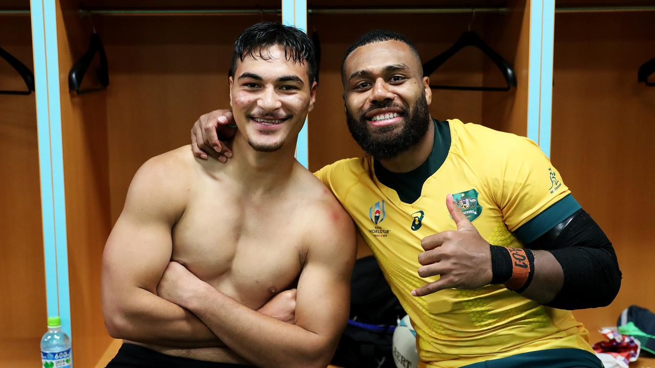 Jordan Petaia and his former Reds midfield teammate Samu Kerevi pose in the changing room after their win over Georgia.
