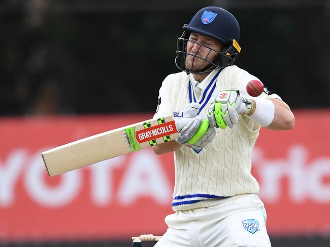 Peter Nevill reacts as he is hit by the ball against Western Australia.