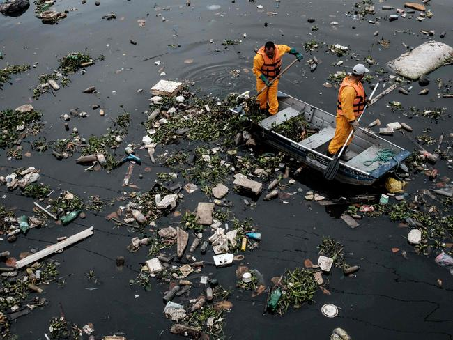Organisers have been scrambling to clean the waterways in the lead up to the games. Picture: Yasuyoshi Chiba